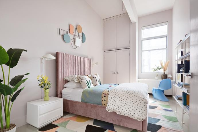 "The guest bedroom boasts the same playful pastel palette as the main living room. *Photo:* [DDreps](http://ddreps.com/|target=""_blank""