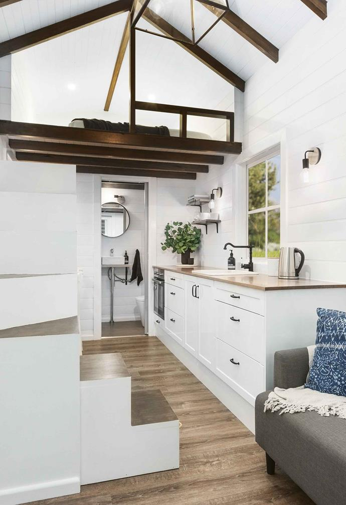 "Loft bedrooms are a clever choice in tiny house design. Steps become a decorative feature in this space by [Tiny Homes Australia](https://www.tinyhouse.com.au/|target=""_blank""