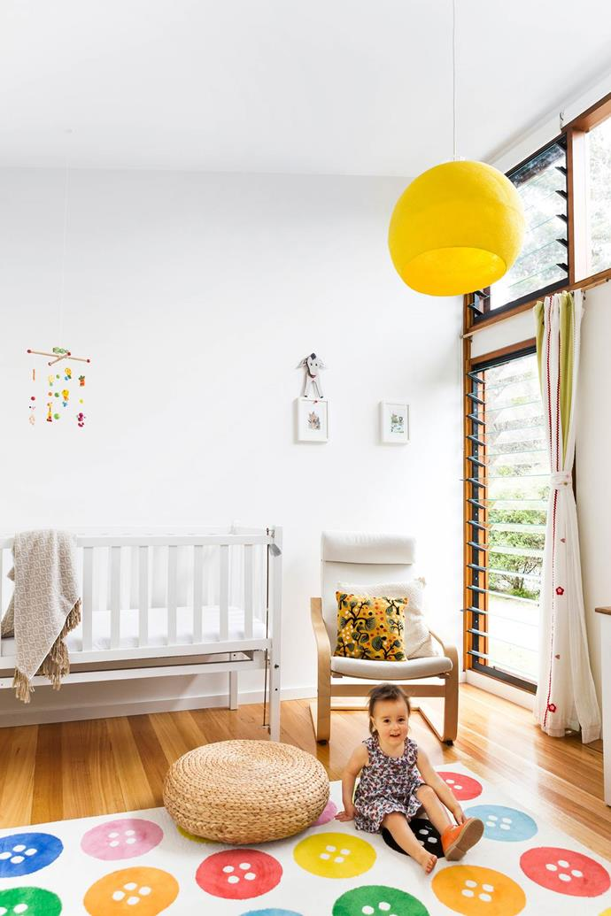 "Fun colours and shapes spark a young imagination in this [playful nursery](https://www.homestolove.com.au/contemporary-coastal-home-provides-the-ultimate-sanctuary-2794|target=""_blank""). Chair, Ikea. Mobile, Make Designed Objects.  *Photograph*: Maree Homer"
