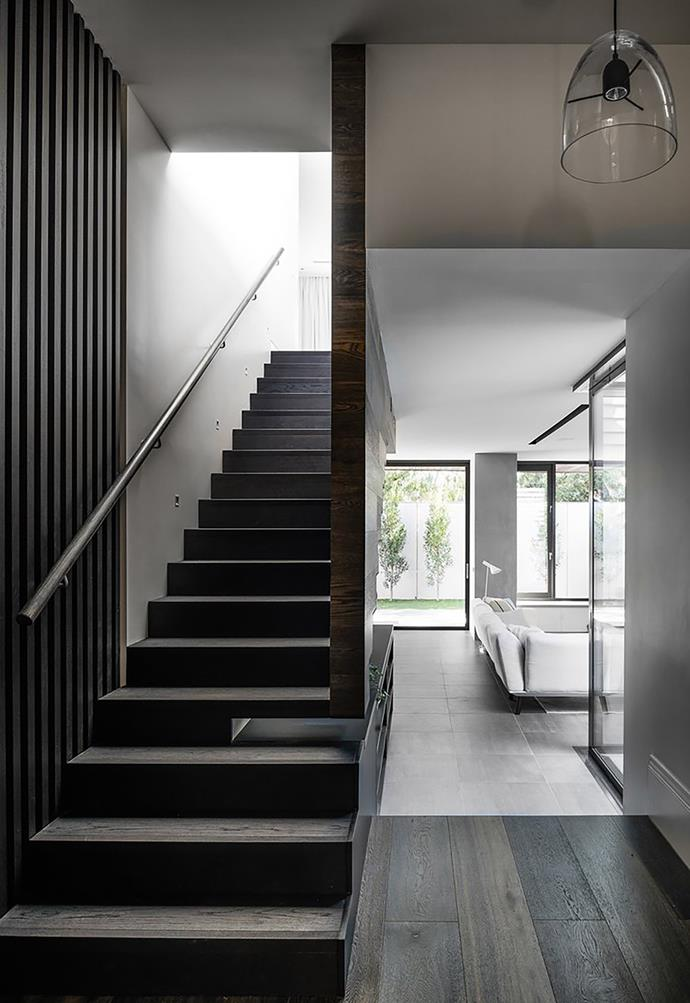 Guests are immediately welcomed with a cantilevered staircase which is a star feature of the home.