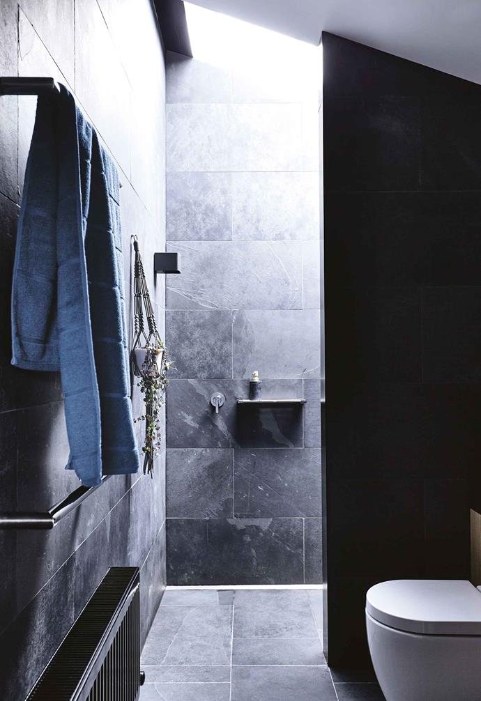 "A [walk-in robe](https://www.homestolove.com.au/walk-in-wardrobe-designs-6290|target=""_blank"") and all-slate ensuite were added, and a new central bathroom created. The shower has no screen, which makes the entire room feel spacious, while the deep vanity with an abundance of drawers will cater for a growing family. ""It needed to have enough storage for four girls, and to be big enough for them all to be in here at the same time,"" says Gabrielle.<br><br>**Ensuite** Eco Outdoor 'Abyss' slate tiles cover the floor and walls of the ensuite, while a skylight offers plenty of natural light and ensures privacy."