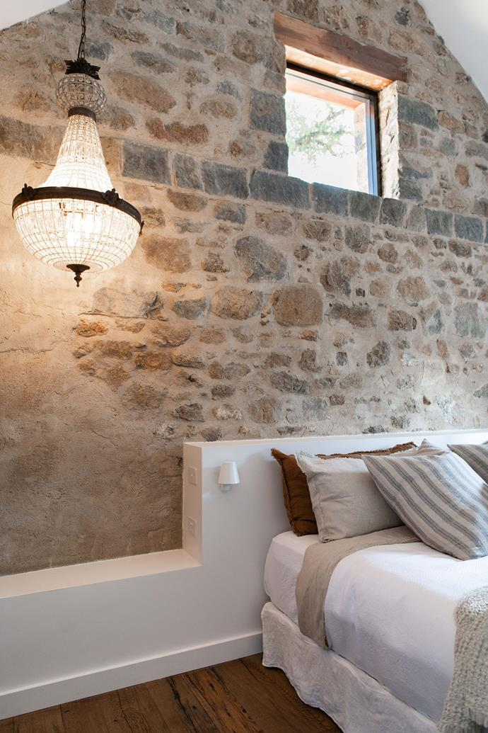 "The granite walls are 500mm thick. A vintage chandelier adds a touch of glam to the simply styled space. The beds are dressed with flax linen from [Hale Mercantile Co](https://halemercantilecolinen.com/|target=""_blank""