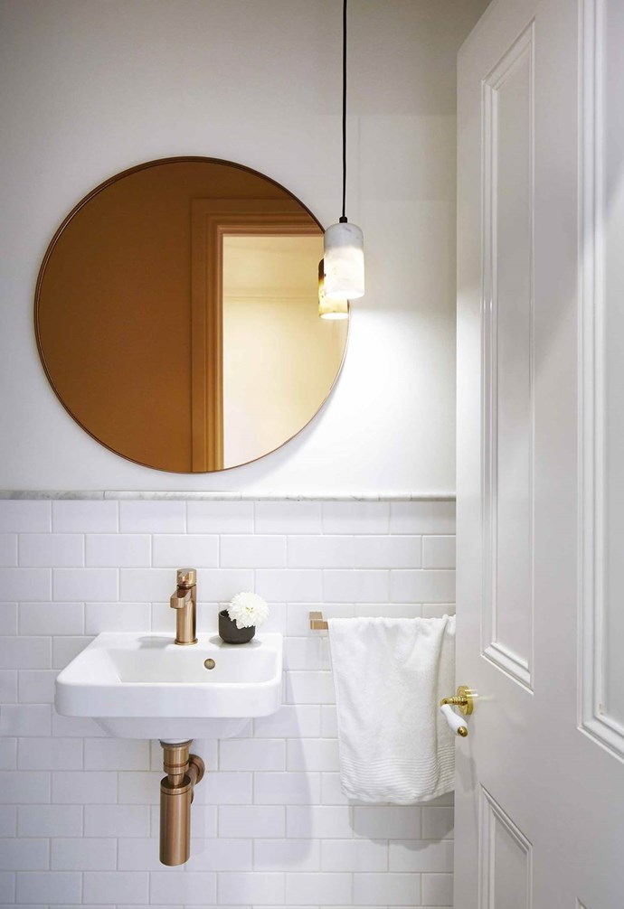 "An elegant **pendant light** illuminates the compact powder room in this [renovated Edwardian home](https://www.homestolove.com.au/modern-edwardian-semi-renovation-18524|target=""_blank"") by [Sarah Harris Design](http://sarahharrisdesign.com.au/