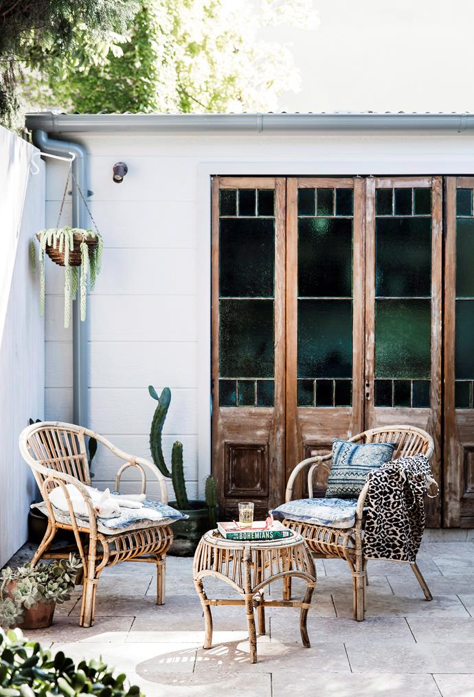 This cane furniture setting is the perfect fit for the small courtyard garden.