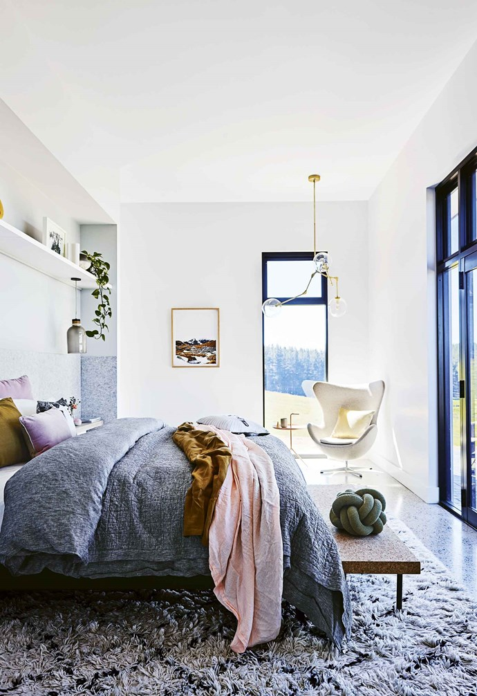 """At the other end, two generous bedrooms, sleeping six (or more if required) and a large bathroom lead to a laundry/mudroom and garage. A mezzanine level provides a retreat for guests and extra sleeping quarters if needed.<br><br>**Master bedroom** Acoustic panels from Bunnings behind the bed lend a cosy feel, as do the Sheridan quilt cover and Major Minor mustard sheet from [The D E A Store](https://thedeastore.com/ target=""""_blank"""" rel=""""nofollow"""")."""