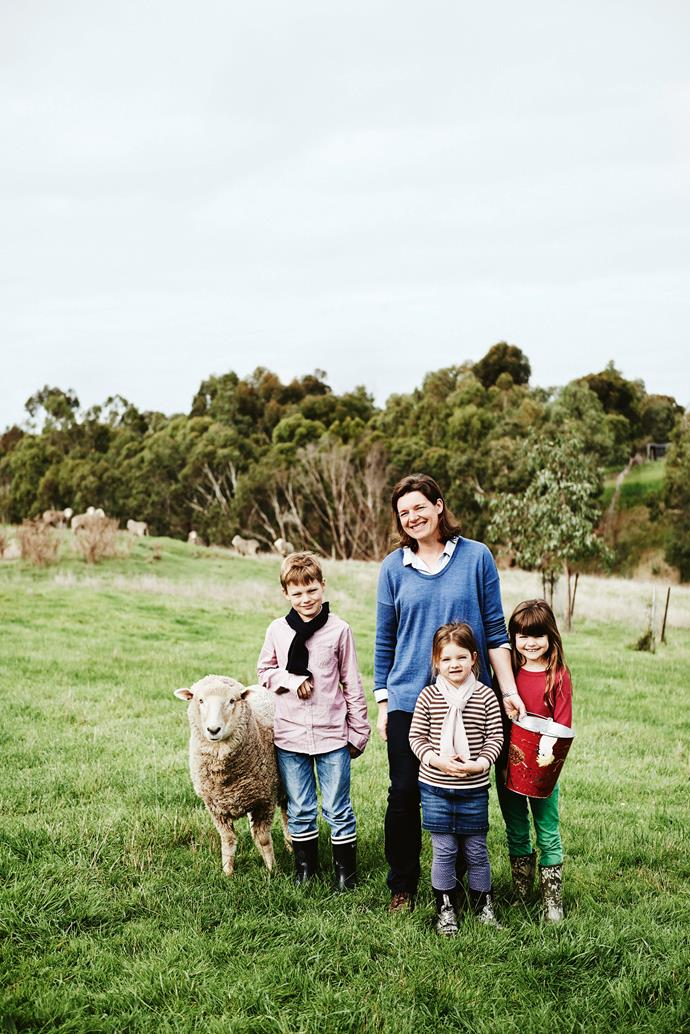 Louise with pet sheep Snowstorm and (from left) Nicholas, Lucy and Clara, all clad in her Snowdrop Merino knitwear.