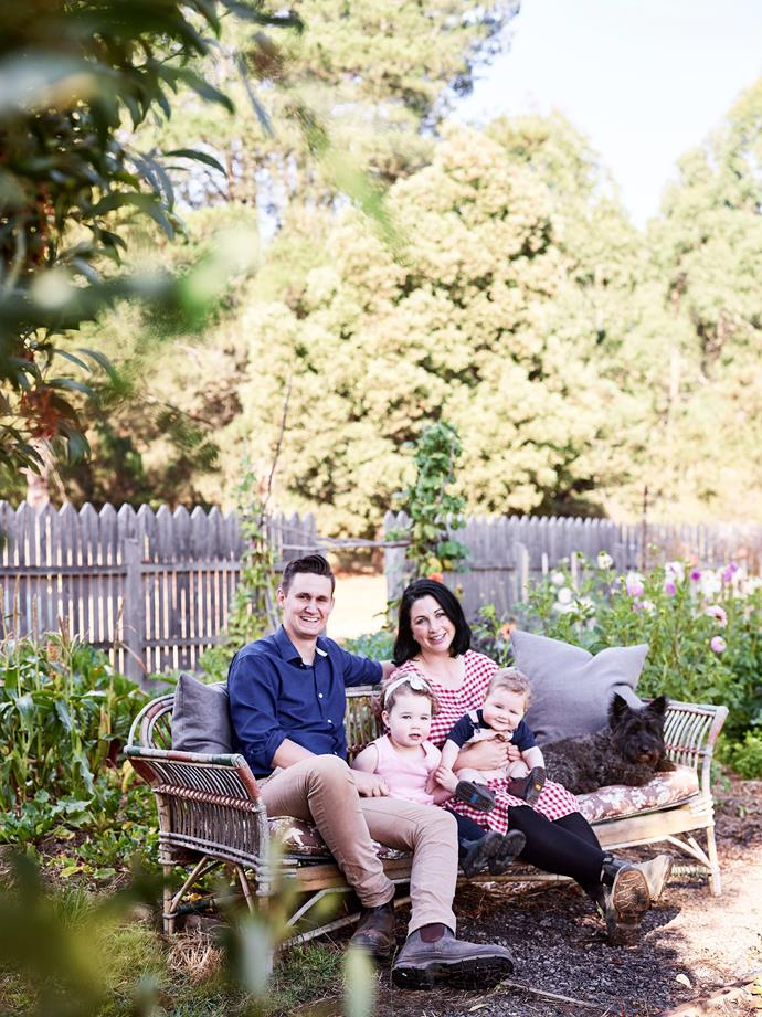 Chris and Janae with Gigi, three, and Atticus, nine months. Peggy, a Scottish terrier and West Highland cross, is never too far away from the family. Janae's father Ian Evans did the landscaping.