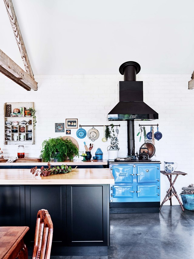 "In this [recycled-brick farmhouse](https://www.homestolove.com.au/recycled-brick-house-20262|target=""_blank""), The Esse wood combustion cooker in Powder Blue is the star of the open-plan kitchen. As well as injecting a healthy dose of colour, it provides the hydronic heating in the concrete slab."