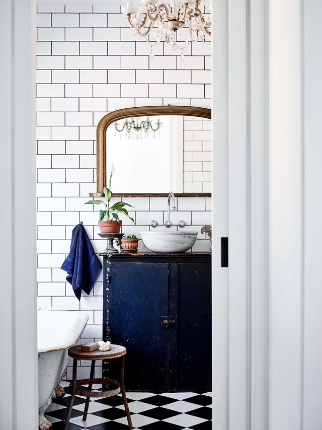 "Newly built homes can sometimes lack warmth and character, but this could not be further from the truth at this [recycled brick home](https://www.homestolove.com.au/recycled-brick-house-20262|target=""_blank"") in Lyonville, Victoria. Here, a vintage cabinet has been converted into a vanity. The use of an above-counter basin means there is more room for storage inside."