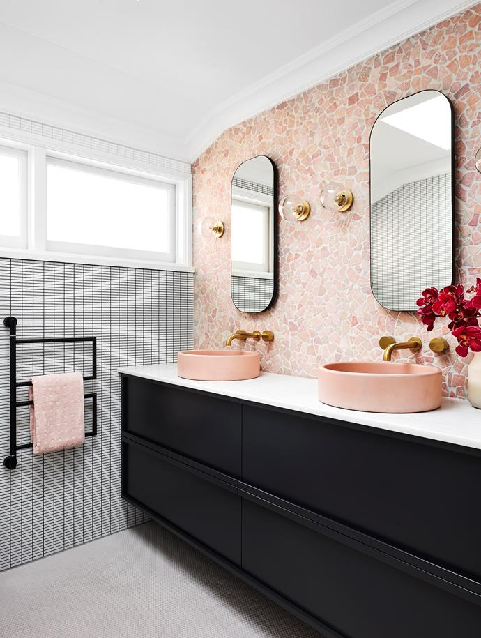 Lynne Bradley Interiors combined a variety of surfaces, colours and texture to create interest, depth and contrast in this bathroom including a stunning feature wall in Rosado pink tiles.