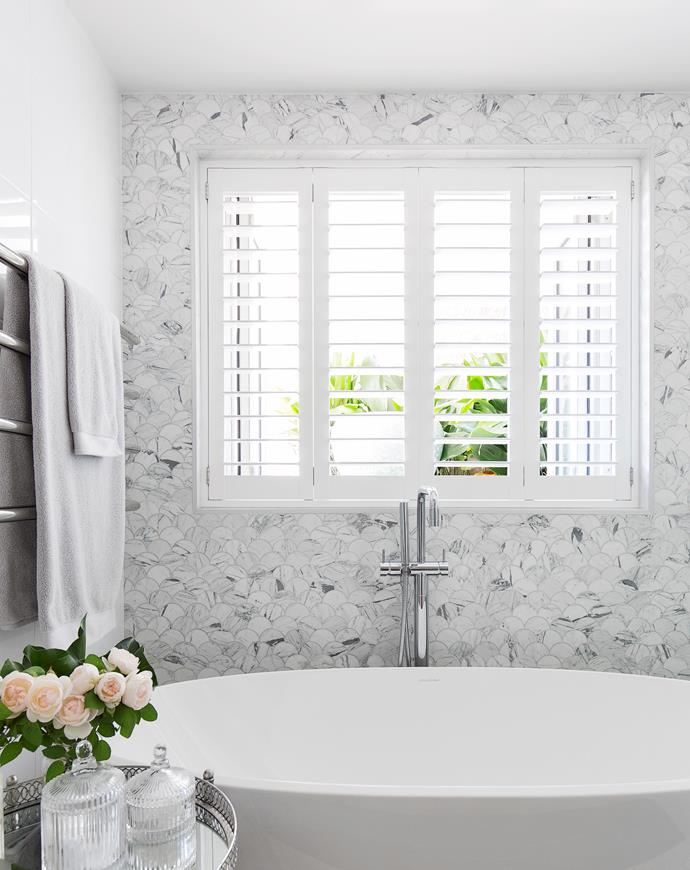 Scalloped marble tiles in this bathroom designed by Alexandra Kidd make for an elegant and interesting feature wall. *Photograph*: Simon Whitbread. From *Belle* February/March 2019.
