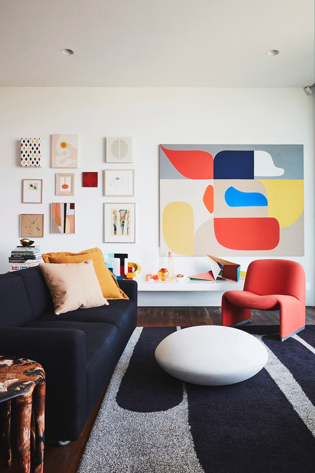 "The [home of Dinosaur Designs founders](https://www.homestolove.com.au/dinosaur-designs-founders-sydney-home-20266|target=""_blank"") Louise Olsen and Stephen Ormandy is a mixture of kaleidoscopic colours and bold artworks. Here, a large artwork by Stephen himself commands attention from the wall while influencing the colour scheme of the room."