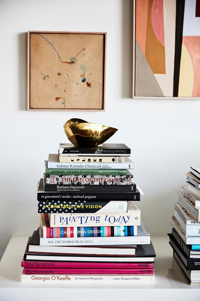 "Louise's love of art and design books is evident in the living room, where piles of her current favourites are piled in neat displays. ""They're inspiring and also great references to look back on,"" she says. ""Some have come from our travels, some from family and friends and others from our favourite book stores."""