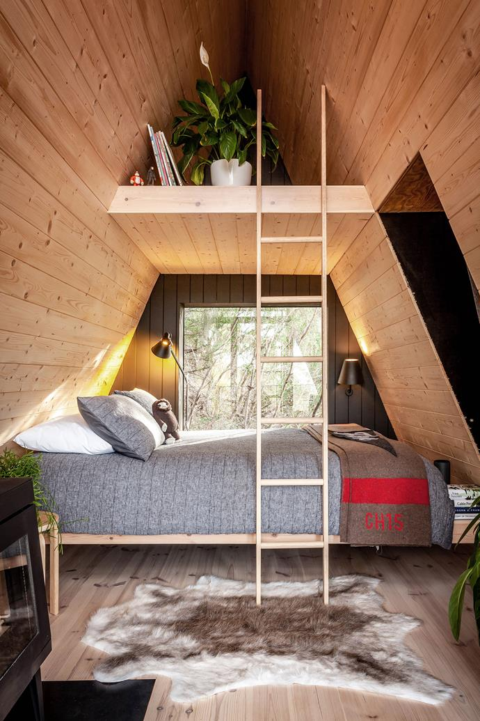 Despite a compact footprint, the interior of the treehouse feels spacious with high ceilings and a loft space. The interior is clad in Baltic Pine.