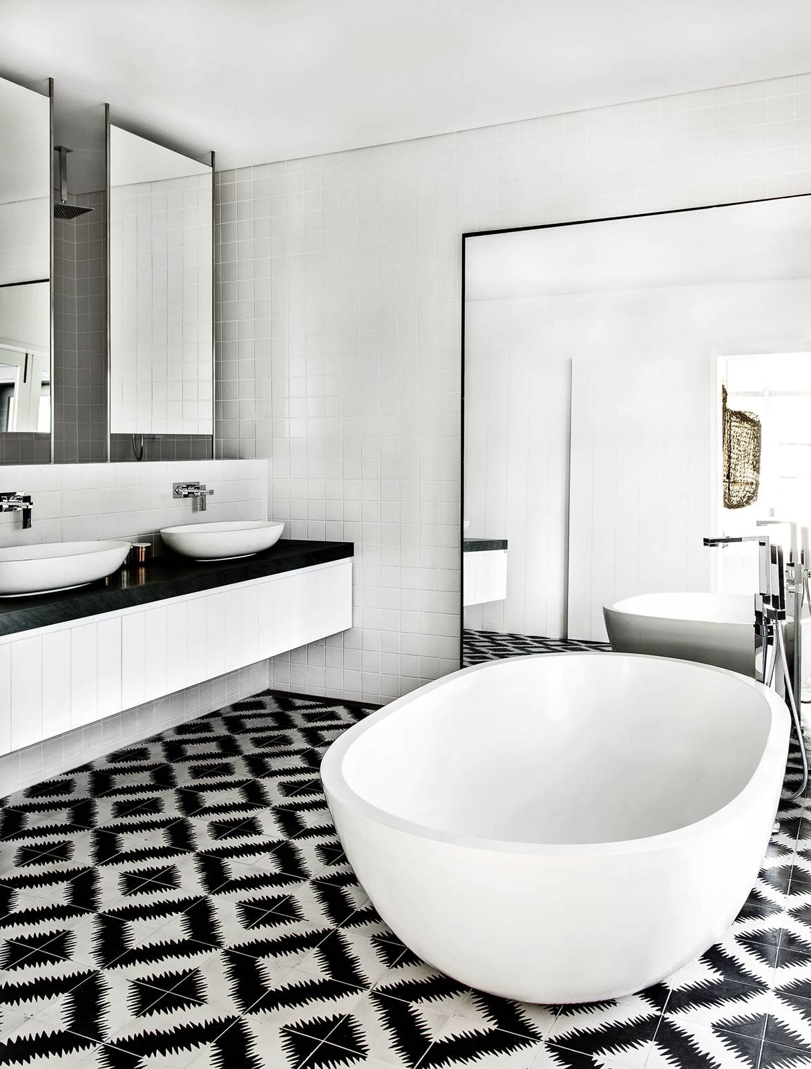 "A [monochrome palette](https://www.homestolove.com.au/gallery-a-waterside-family-home-on-sydneys-northern-beaches-1448 in this bathroom, designed by Pamela Makin of Les Interieurs, is made more interesting with graphic |target=""_blank"") Design ZigZag handmade floor tiles."