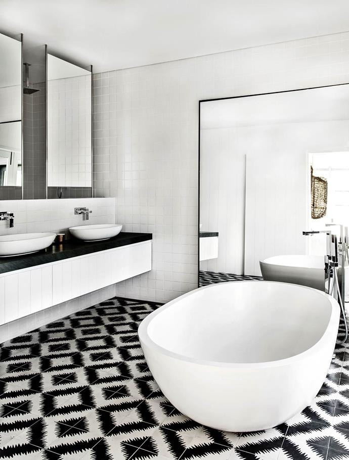 "A [monochrome palette](https://www.homestolove.com.au/gallery-a-waterside-family-home-on-sydneys-northern-beaches-1448|target=""_blank"") in this bathroom, designed by Pamela Makin of Les Interieurs, is made more interesting with graphic Popham Design ZigZag handmade floor tiles."