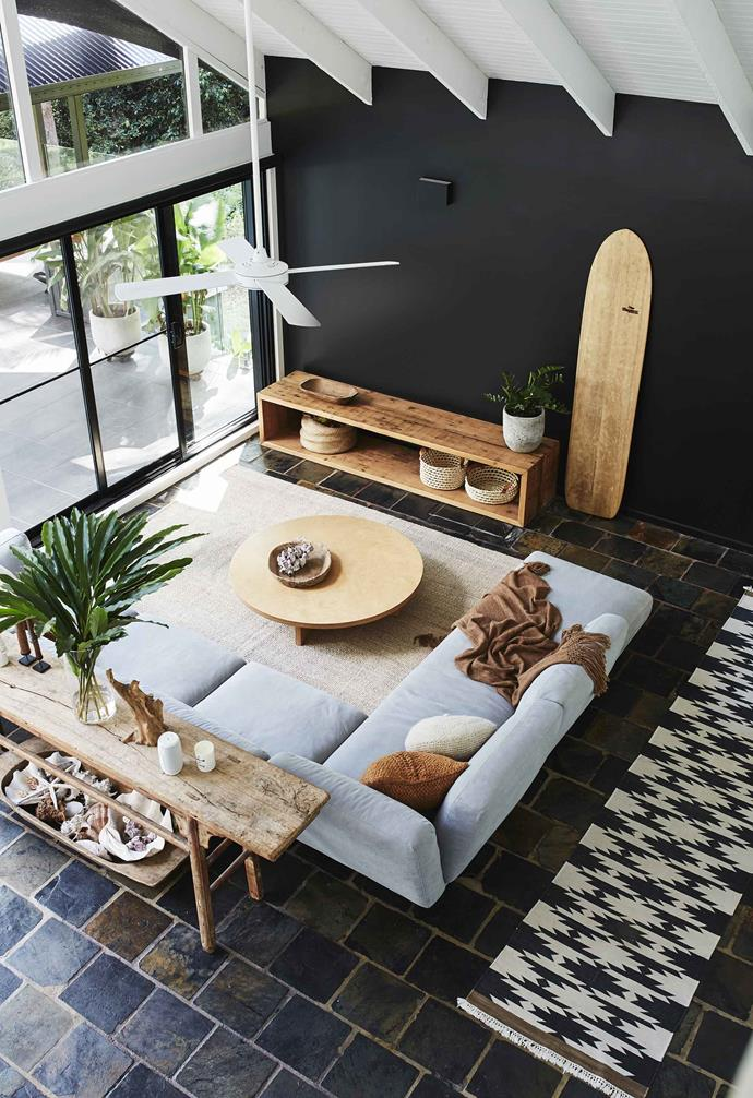 "**Living area** Views are savoured through a wall of sliding doors. Adam built the TV unit from recycled wood – next to it, an Alaia wood surfboard by Tom Wegener is a work of art that gets lots of use at the beach. ""The fan is from [Beacon Lighting](https://www.beaconlighting.com.au/