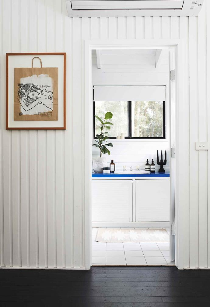 **Bathroom** The plan is to replace the cobalt vanity top when the bathroom is renovated. Artwork by US snowboarder and artist Jamie Lynn.