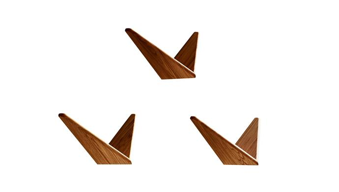 "Dk3 'Butterfly' walnut wall shelf, $480/pair, [Great Dane](https://greatdanefurniture.com/danish-furniture/shelving/butterfly-shelves-walnut-or-oak|target=""_blank""