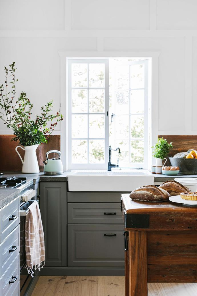 The newly renovated kitchen has loads of warmth and character, thanks to timber details and the Havsen farm sink and Glittran kitchen mixer, both from IKEA. Gerard made the concrete benchtops in the kitchen while the cupboards and sink are from IKEA.