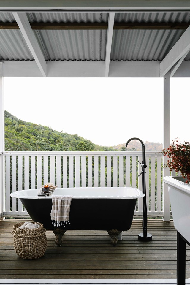 "The owners of this [barn-style home](https://www.homestolove.com.au/barn-style-kit-home-australia-20272|target=""_blank"") have incorporated a beautiful claw-foot bath into the design of their undercover deck to take advantage of the sweeping views the Noosa Hinterland."