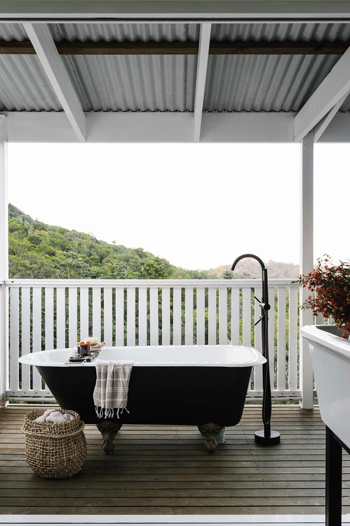 The outdoor claw-foot bath was a Gumtree find; the floor-mounted tap with hand shower is from Astra Walker.