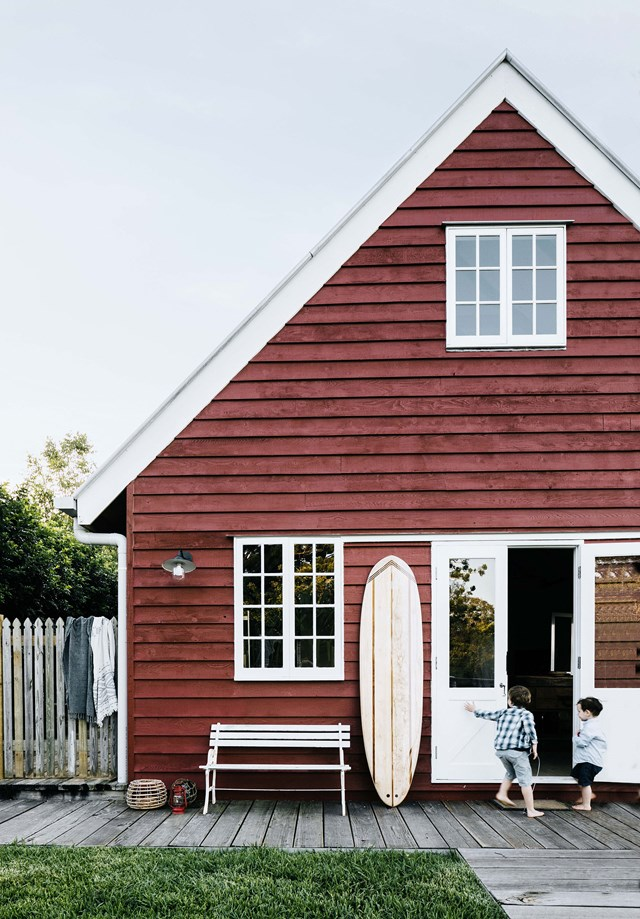 "Rachel Luchetti and her builder husband Gerard Cook have transformed a [barn style kit home](https://www.homestolove.com.au/barn-style-kit-home-australia-20272|target=""_blank"") into a family retreat known affectionately as the Little Red Barn. The red exterior sets this home apart as does the concrete plunge pool with views   of the hinterland."