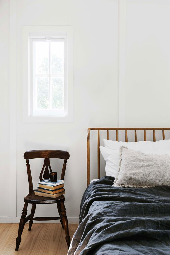 Freshly painted white walls and window frames, and antique bedroom furniture, sourced by Rachel on Gumtree, add to the cosy country feel. The Winchester Spindle bed from Pod Furniture in the UK is dressed with bedlinen from The Beach People.