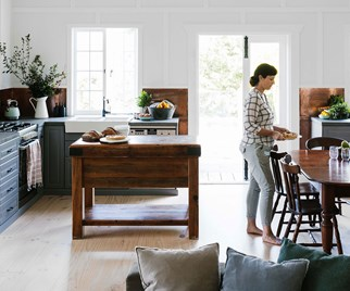 Woman in modern style country kitchen