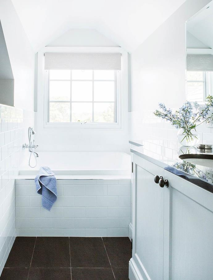 Big things come in small packages if this bathroom within a Hamptons-style home is anything to go by.