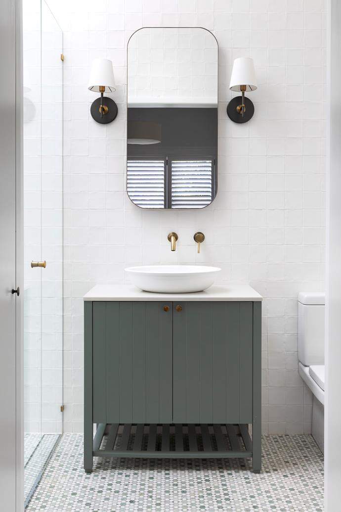 'Incorporating mirror storage means you don't need a large vanity,' says Franco Parisi. The custom cabinetry (in Porter's Paints Blue Spruce) is so gorgeous in this Sydney ensuite you barely notice how small the room is.