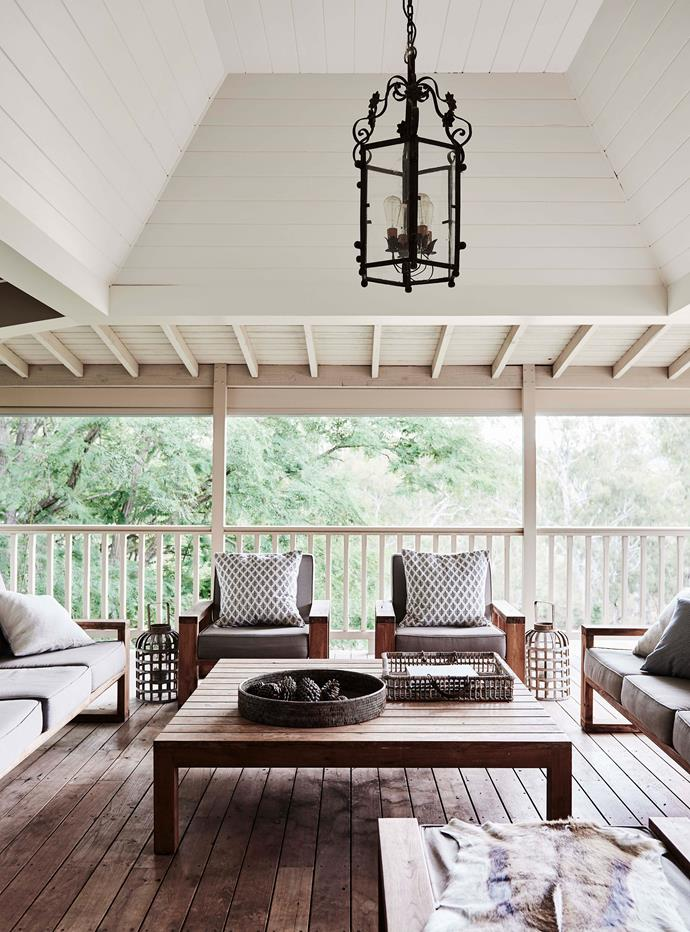 The chairs on the enclosed verandah were custom-made by Robert Plumb using Woodstock Resources recycled teak from India, while Angus and Emma's outdoor chandelier is from Pantry on Pudman in Boorowa.