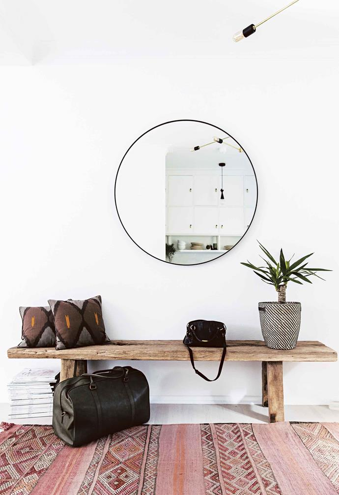 "**Steven, why did you engage an interior designer?** I had ideas about how I wanted the space to feel, but wasn't able to translate that into reality on my own. I especially needed help [maximising the space](https://www.homestolove.com.au/small-space-decorating-ideas-19758|target=""_blank"") and the storage potential in the apartment. I wanted a dramatic transformation of what was a badly executed and planned unit into something special that I could be proud of. I'm drawn to natural materials, such as leather, stone and wood, so incorporating these elements in the apartment was a non-negotiable.<br><br>**Entry**  A [Middle Of Nowhere](http://www.middleofnowhere.com.au/