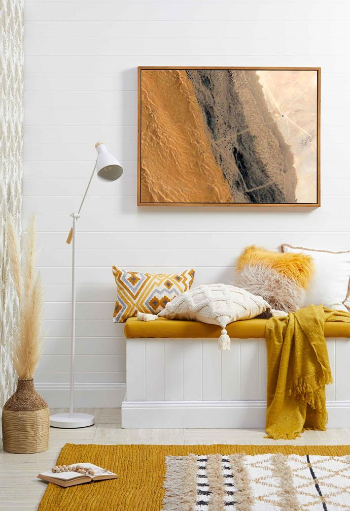 For homes with a stark white palette, pops of vibrant saffron can brighten every nook and cranny.
