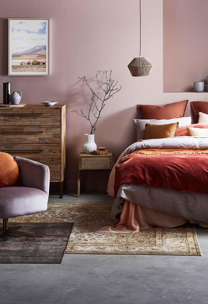 Muted blush pink is paired with bright pops of autumnal oranges and reds to create a warm space.