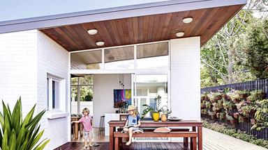 A weatherboard house was given a retro mid-century modern revamp