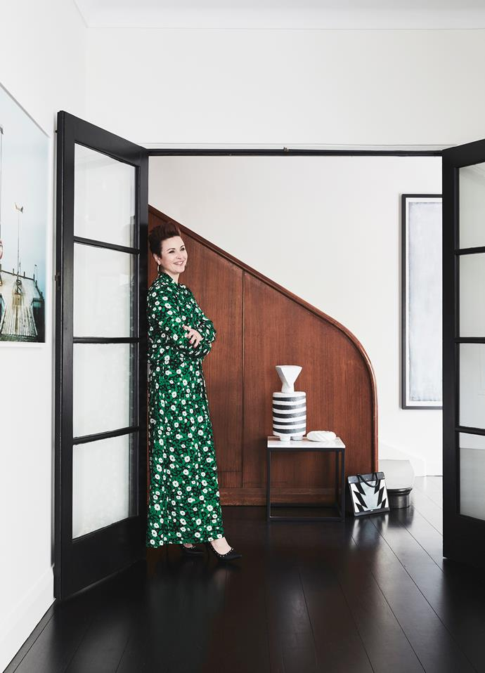 """Even though we've done the renovation, you can still see the past in it,"" Sophie says of her home. She stands next to a framed photo by Mikael Lafontan."
