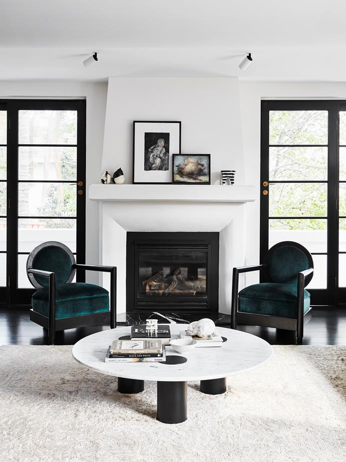 French doors create symmetry in the living room, which turns the spotlight on the hand-carved fireplace. Sophie discovered the armchairs at an auction house and had them reupholstered.