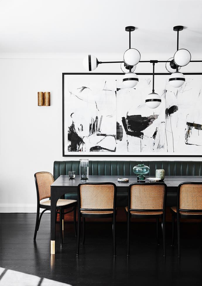 Sophie enlisted furniture maker Tim Noone to create her Curatorial dining table, with the custom banquette and Thonet 'Hoffmann' chairs providing seating for 10. A limited-edition Peggy chandelier by Hangar Design Group hangs above. The triptych artwork is by Antonia Mrljak.