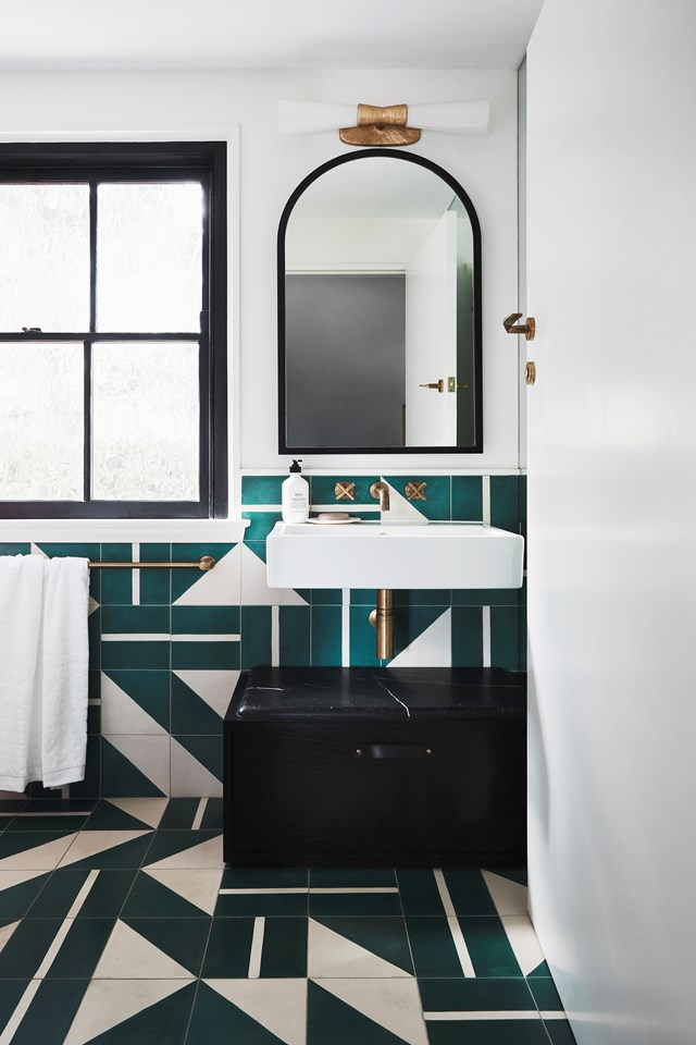 "Two different types of emerald green Brasilia tiles from Popham Design were used to create this eye-catching pattern in the powder room of this [modern Art Deco home](https://www.homestolove.com.au/modern-art-deco-home-20290|target=""_blank"")."