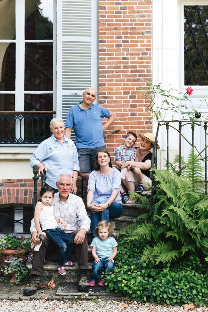 """Flore (top right) with her parents Etienne and Marie, brother Louis and his wife Marie-Noëlle, and their children Antoine, Claire and Jeanne. As to what her parents thought when she put forth the idea to open up their house and garden to strangers: """"I was very lucky that my parents trusted me immediately,"""" says Flore. """"I had enthusiastically talked about the three workshops I had previously attended in Australia and told them how life-changing they had been for me. I explained that the people who would come to their house would be passionate and respectful. That's all it took."""""""