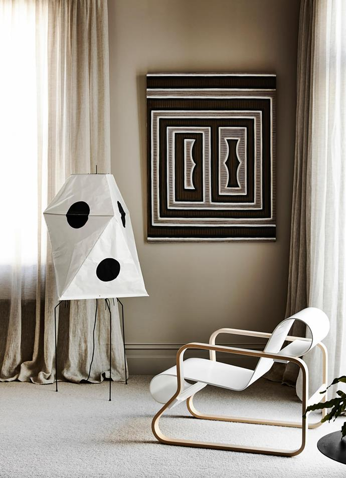 In the sitting room of the renovated old wing of the home is an Artek 41 'Paimio' armchair by Alvar Aalto from Anibou. Akari 'UF3-Q' floor lamp by Isamu Noguchi. Painting by Paul Boston from Niagara Galleries.