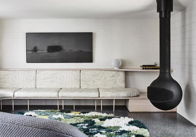 ec for Ligne Roset from Domo. Custom daybed designed by Kennedy Nolan and upholstered in 'Grafitto' fabric by Kelly Wearstler from Elliott Clarke. 'Bathyscafocus' suspended fireplace from Oblica. Painting by Kevin Lincoln from Niagara Galleries.
