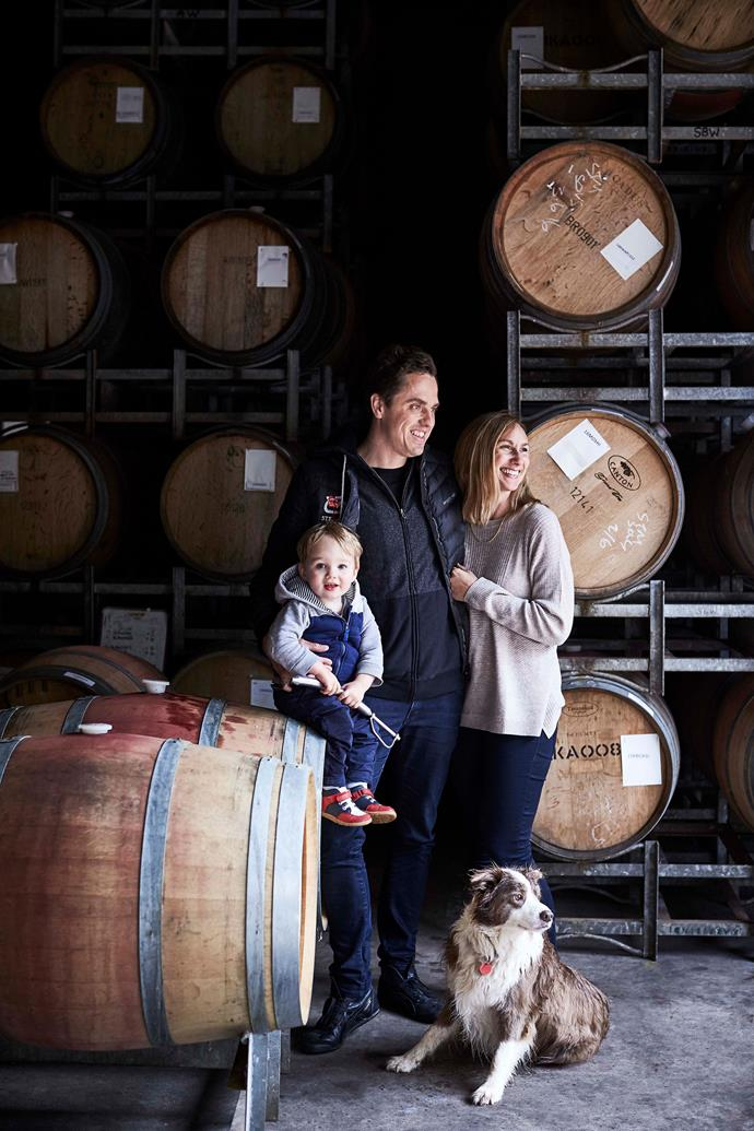 Chief winemaker Luke Jolliffe and his wife Maree with son Lenny and border collie Matilda in the barrel hall at Stella Bella winery in Karridale.