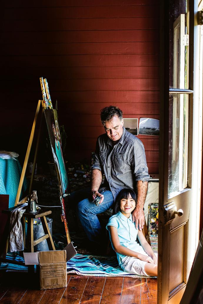 "Daughter Sophie keeps Nick company in his studio while he works on a new piece, Where I'm From. Nick went to boarding school in Mungindi when he was seven, then boarded in Lismore before moving to Sydney to study Greek and Roman literature. He had no plans to [return to the country](https://www.homestolove.com.au/families-who-moved-to-country-australia-19642|target=""_blank"") — but when he was diagnosed with cancer, he moved to Moree to be near his parents, who had relocated into town during a bad drought. ""It was not the plan but I needed the support,"" he says. Nick recovered from the cancer, married and started gardening."