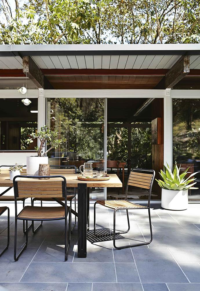 """We really didn't have to do anything,"" says Danielle. ""It was designed so well that we just enjoy the flow of the spaces. This is a perfect family home. Even the kitchen is original and still works really well for our family.""<br><br>**Outdoor area** A sliding glass door leads from the dining room to an outdoor living area designed in conjunction with Brisbane landscape designer Steven Clegg. The 'Colo' dining table is paired with 'Turon' chairs, both from [Eco Outdoor](https://www.ecooutdoor.com.au/
