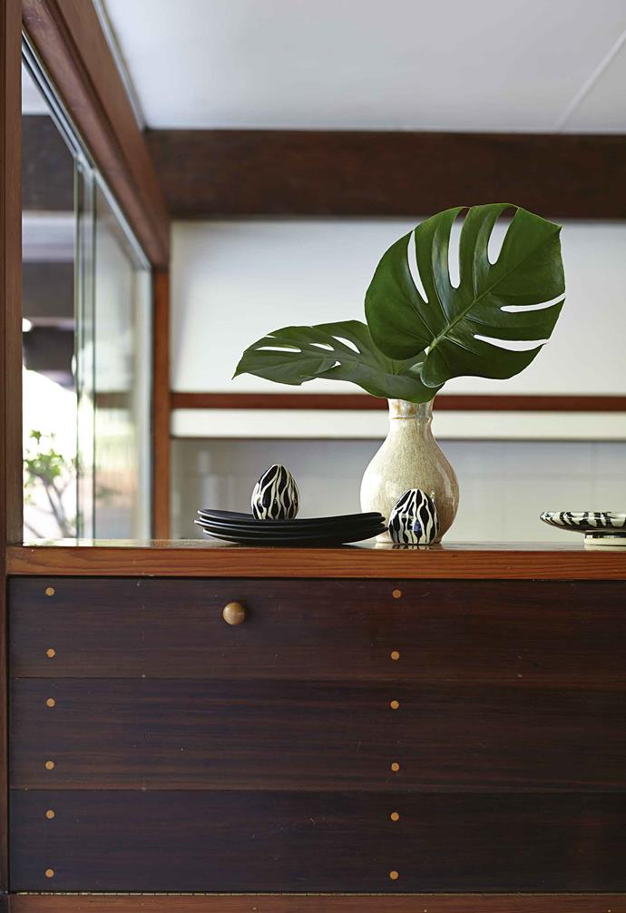 "He is also passionate about his collection of Scandinavian retro furniture, while other pieces such as the Parker lounge suite were transported from Danielle's Sydney digs. ""My apartment was so cramped I was about to get rid of it all and start again, then it found its place here,"" she says. ""I fell in love with it all over again.""<br><br>**Bright idea** This built-in storage sits between the kitchen and dining area, forming a see-through avenue."