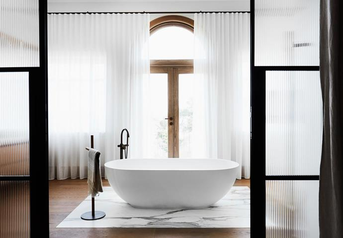 Moda bath from ACS Designer Bathrooms and freestanding towel holder from Boffi.