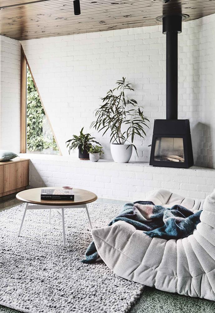 In Australia's cooler climates, a wood burner is a popular feature in living areas. The small-but-mighty Skantherm 'Shaker' slow combustion wood heater from Oblica gets the job done in this Melbourne home.