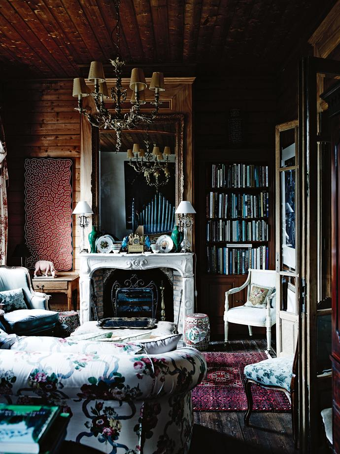 """The main sitting room features a French stone mantel with a pair of Limoges fruit plates, green Chinese vases and bedside lamps that belonged to Jeff's mother. The painting is Women's Journey, from an artist in Utopia, NT, and the floral chintz on the sofa is from UK firm Titley and Marr, represented in Australia by [Radford Furnishings](https://www.radfordfurnishings.com.au/